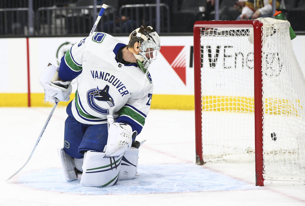 Vancouver Canucks goaltender Jacob Markstrom (25) gets scored on by Golden Knights center Jonathan Marchessault, not pictured, during the first period of an NHL hockey game at T-Mobile Arena in La ...