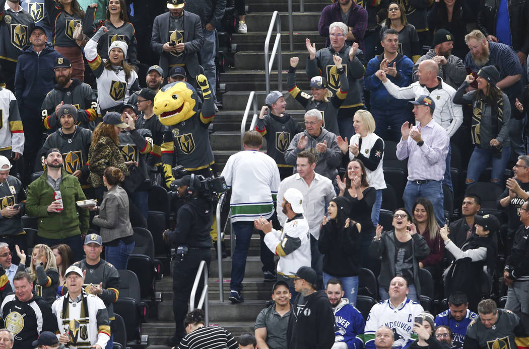 Golden Knights fans celebrate goal by left wing Tomas Tatar, not pictured, during the second period of an NHL hockey game against the Vancouver Canucks at T-Mobile Arena in Las Vegas on Tuesday, M ...