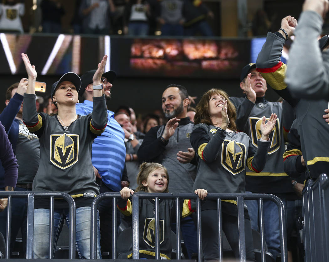 Golden Knights fans celebrate a goal by center Cody Eakin (21) against the Vancouver Canucks during the first period of an NHL hockey game at T-Mobile Arena in Las Vegas on Tuesday, March 20, 2018 ...