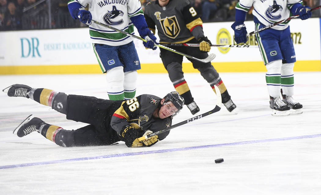 Golden Knights left wing Erik Haula (56) gets tripped up by Vancouver Canucks defenseman Alexander Edler, not pictured, during the third period of an NHL hockey game at T-Mobile Arena in Las Vegas ...