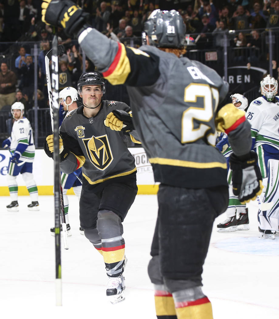 Golden Knights center Ryan Carpenter, left, reacts after a goal by Golden Knights center Cody Eakin (21) during the first period of an NHL hockey game at T-Mobile Arena in Las Vegas on Tuesday, Ma ...