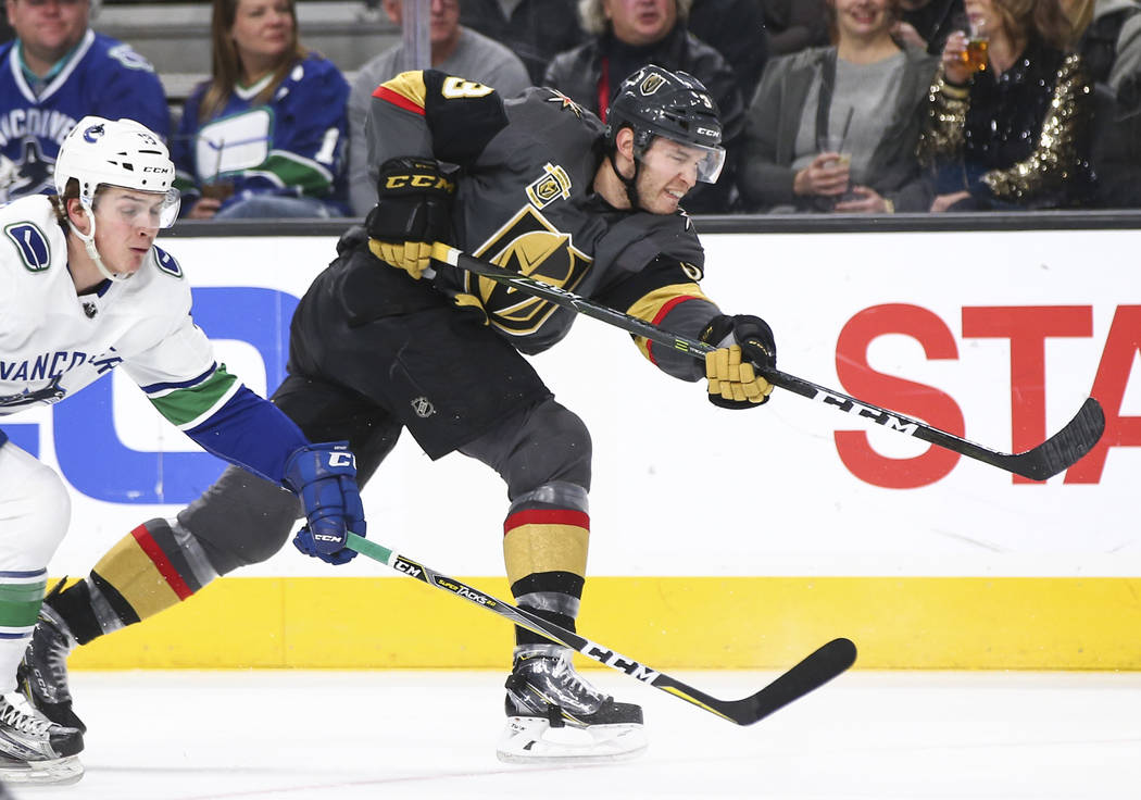 Golden Knights defenseman Brayden McNabb (3) passes the puck during the first period of an NHL hockey game against the Vancouver Canucks at T-Mobile Arena in Las Vegas on Tuesday, March 20, 2018.  ...