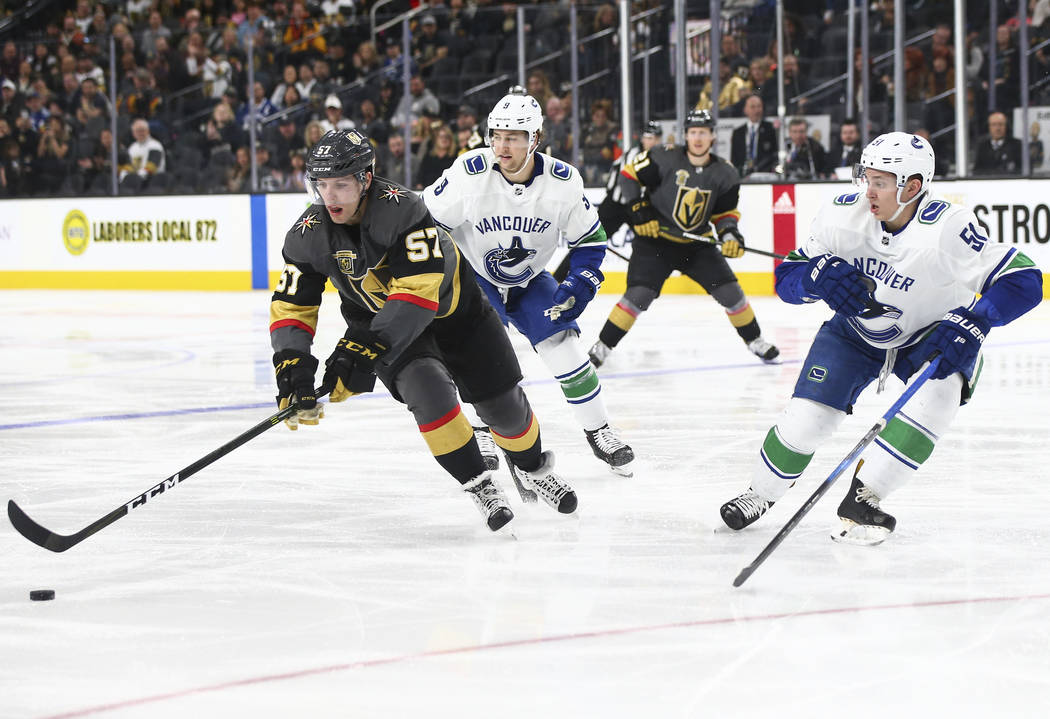 Golden Knights left wing David Perron (57) controls the puck against Vancouver Canucks defenseman Troy Stecher (51) during the third period of an NHL hockey game at T-Mobile Arena in Las Vegas on  ...