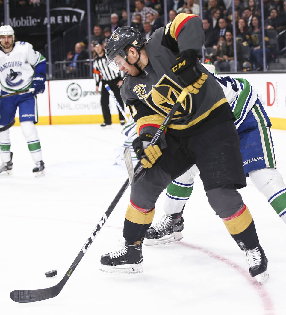 Golden Knights center Jonathan Marchessault (81) controls the puck against the Vancouver Canucks during the third period of an NHL hockey game at T-Mobile Arena in Las Vegas on Tuesday, March 20,  ...