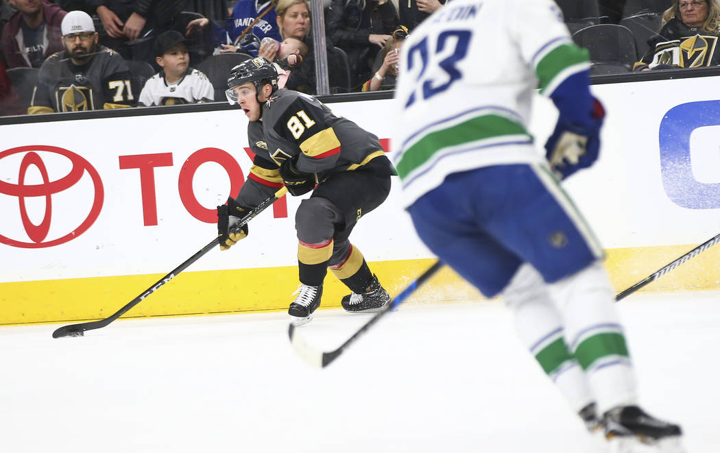 Golden Knights center Jonathan Marchessault (81) controls the puck against the Vancouver Canucks during the first period of an NHL hockey game at T-Mobile Arena in Las Vegas on Tuesday, March 20,  ...