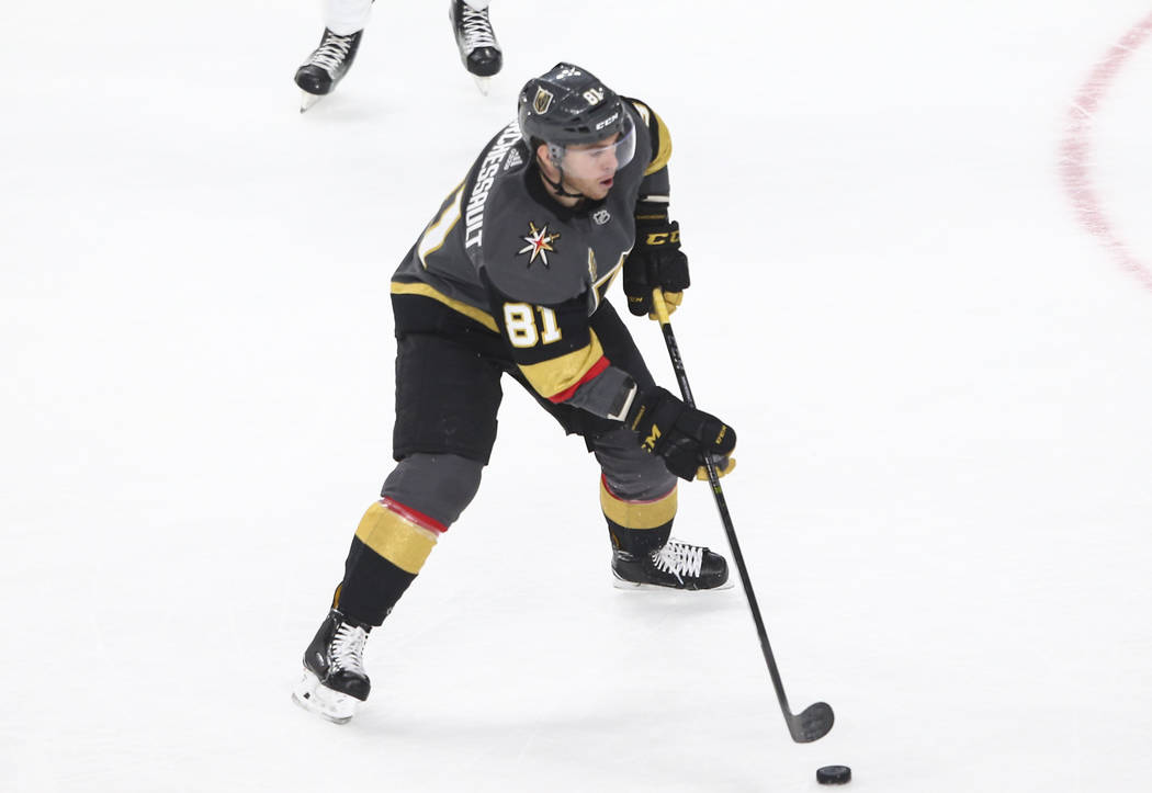 Golden Knights center Jonathan Marchessault (81) lines up a shot against the Vancouver Canucks during the second period of an NHL hockey game at T-Mobile Arena in Las Vegas on Tuesday, March 20, 2 ...
