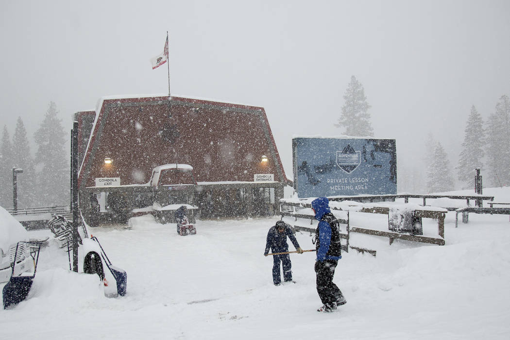 Employees clear snow at the top of the Big Springs Gondola Friday, March 16, 2018, in Truckee, Calif. (Colin Lygren/Northstar California via AP)