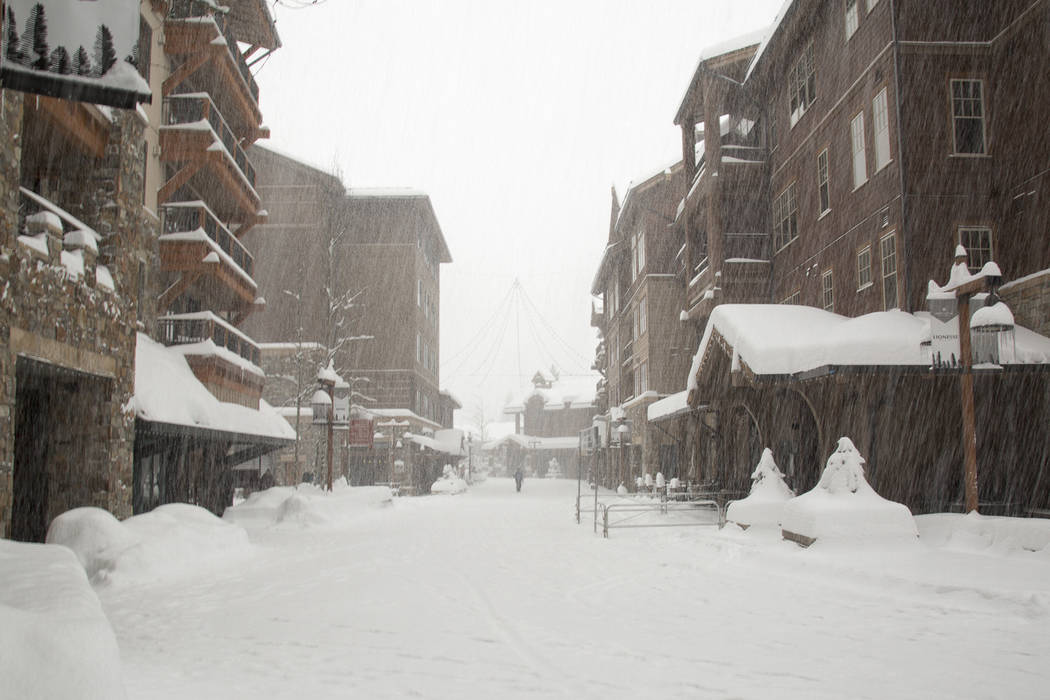Snow continues to pile up in the Village at Northstar Friday, March 16, 2018, in Truckee, Calif. (Colin Lygren/Northstar California via AP)