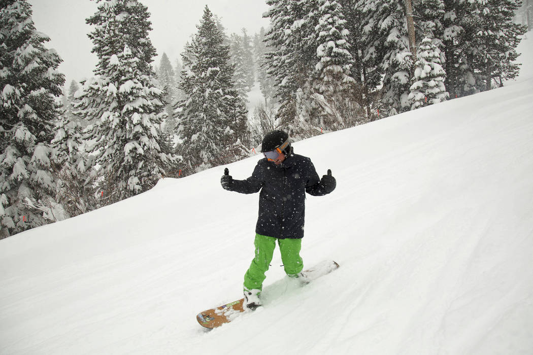 A snowboarder slides through fresh snow at the Northstar California Resort, Friday, March 16, 2018, in Truckee, Calif. (Colin Lygren/Northstar California via AP)