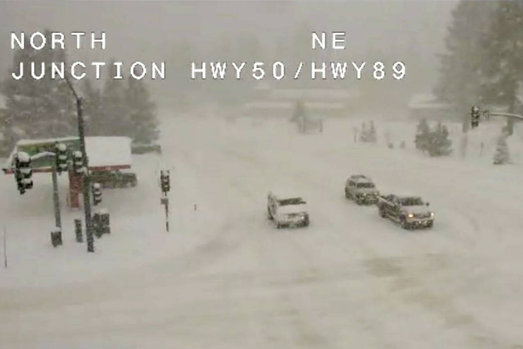 This traffic camera image provided by Caltrans shows conditions at the Y intersection of Highways 50 and 80 Friday, March 16, 2018, in South Lake Tahoe, Calif. (Caltrans via AP)