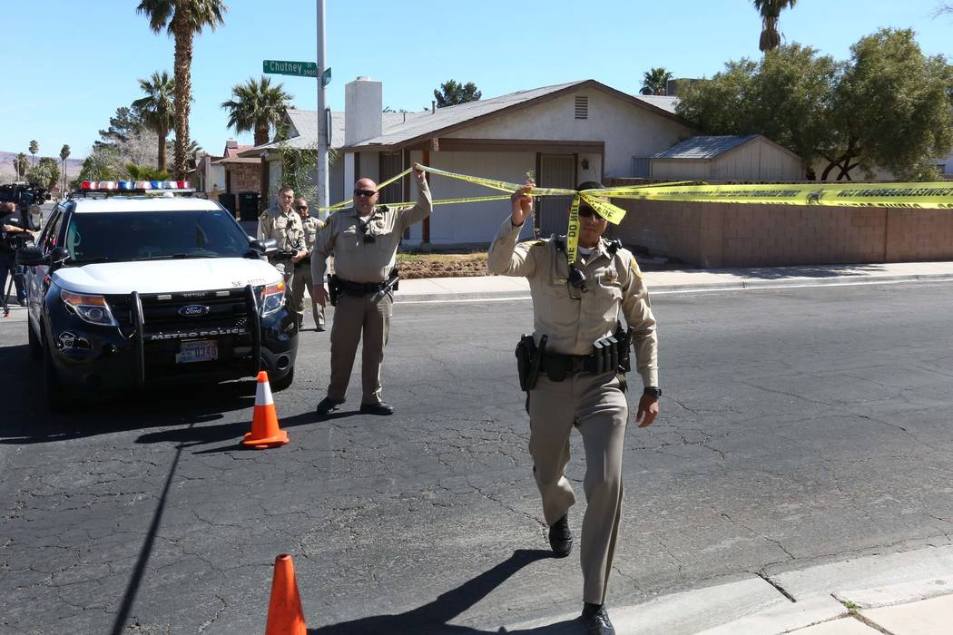 Las Vegas police block off Chutney Street as they investigate a double shooting at Bridle Court and Lasso Circle, near Flamingo Road and Boulder Highway, on Tuesday, March 6, 2018. Two men died in ...