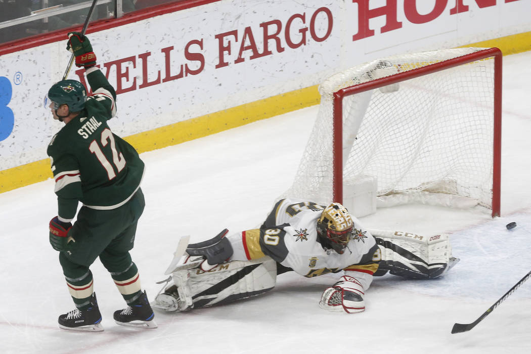 Minnesota Wild's Eric Staal, left, scores on Vegas Golden Knights goalie Malcolm Subban during the first period of an NHL hockey game Friday, Feb. 2, 2018, in St. Paul, Minn. (AP Photo/Jim Mone)