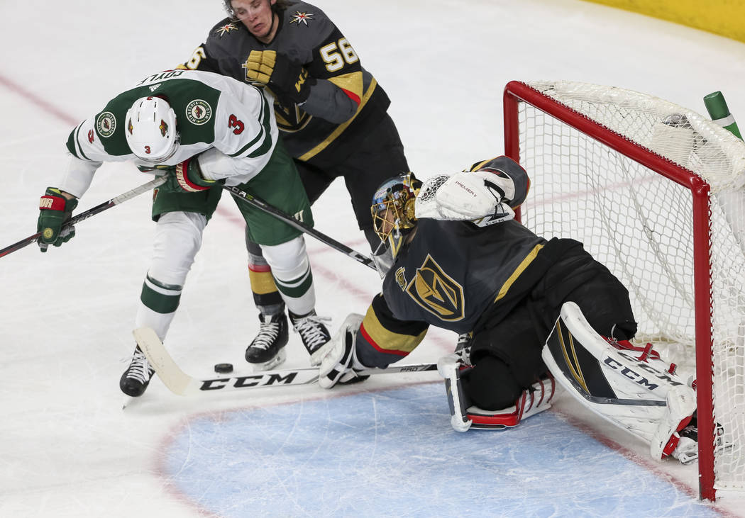Vegas Golden Knights goaltender Marc-Andre Fleury (29) defects the puck from Minnesota Wild center Charlie Coyle (3) during the first period of an NHL hockey game between the Vegas Golden Knights  ...