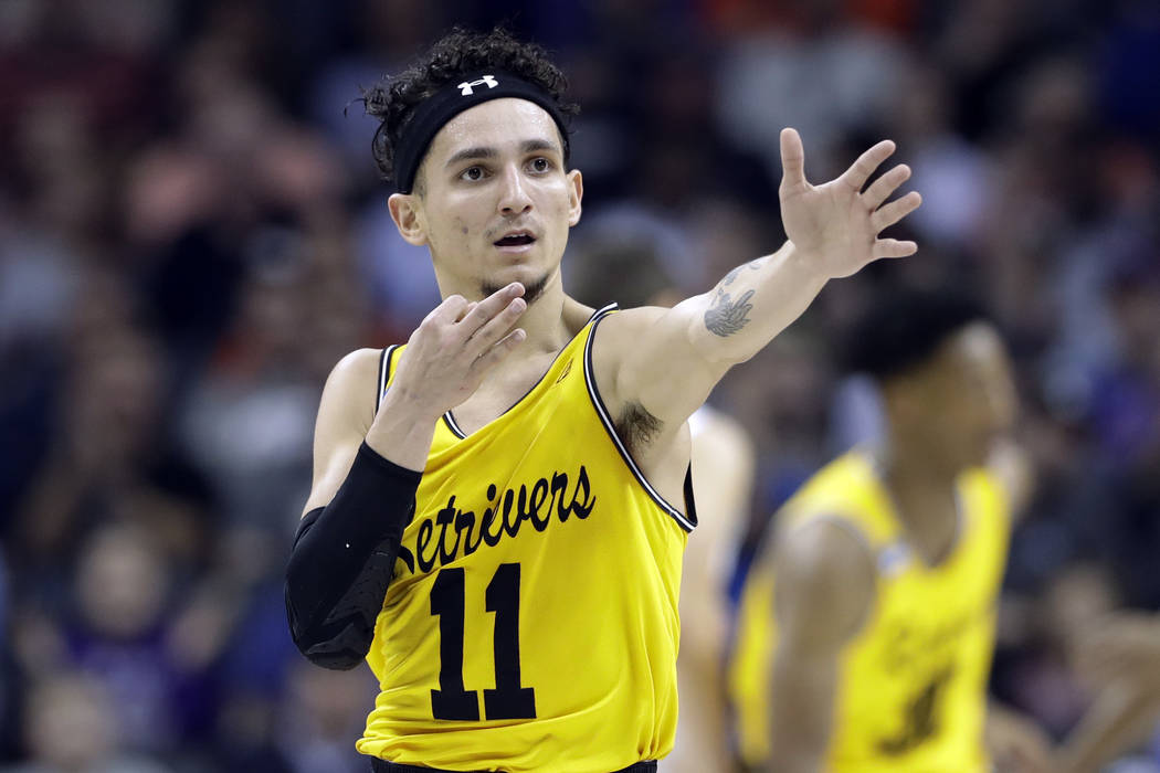 UMBC's K.J. Maura (11) celebrates after a basket against Virginia during the first half of a first-round game in the NCAA men's college basketball tournament in Charlotte, N.C., Friday, March 16,  ...