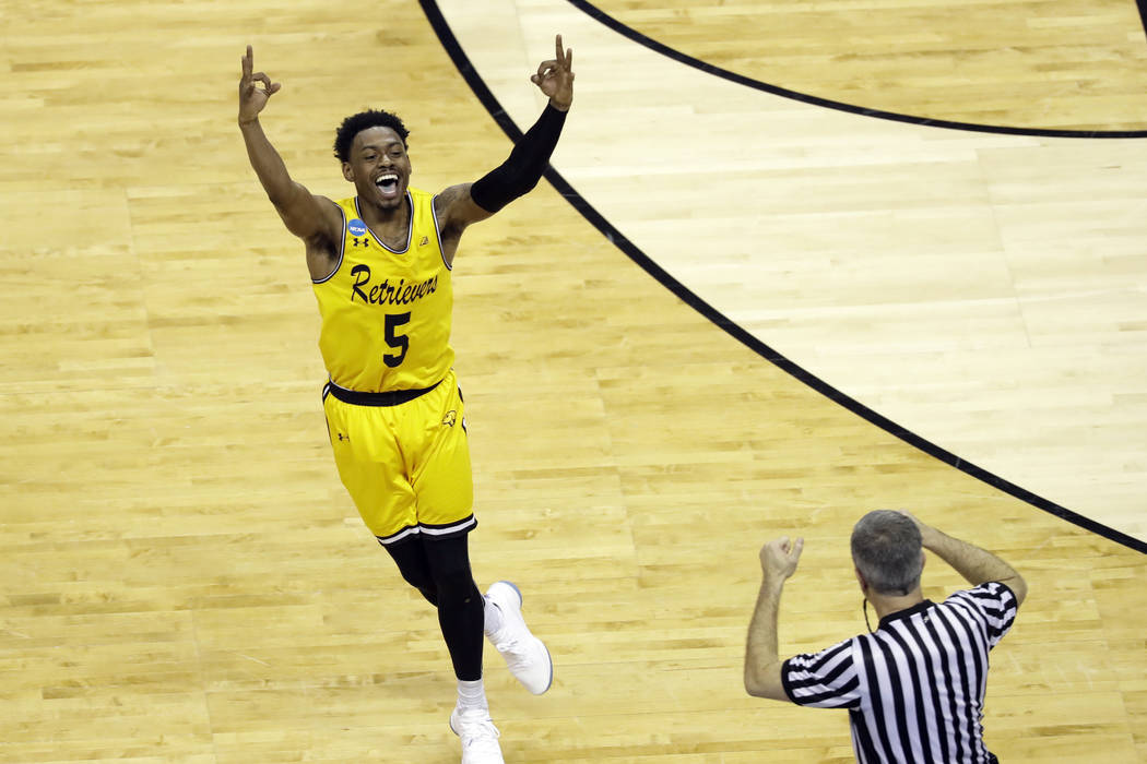 UMBC's Jourdan Grant celebrates after a basket against Virginia during the second half of a first-round game in the NCAA men's college basketball tournament in Charlotte, N.C., Friday, March 16, 2 ...