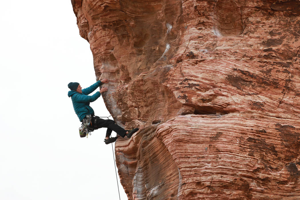 Eric Wesseling of Cincinnati, Ohio, figures out his next holds while climbing at Calico Basin during Red Rock Rendezvous on Saturday, March 17, 2018. Andrea Cornejo Las Vegas Review-Journal @DreaC ...