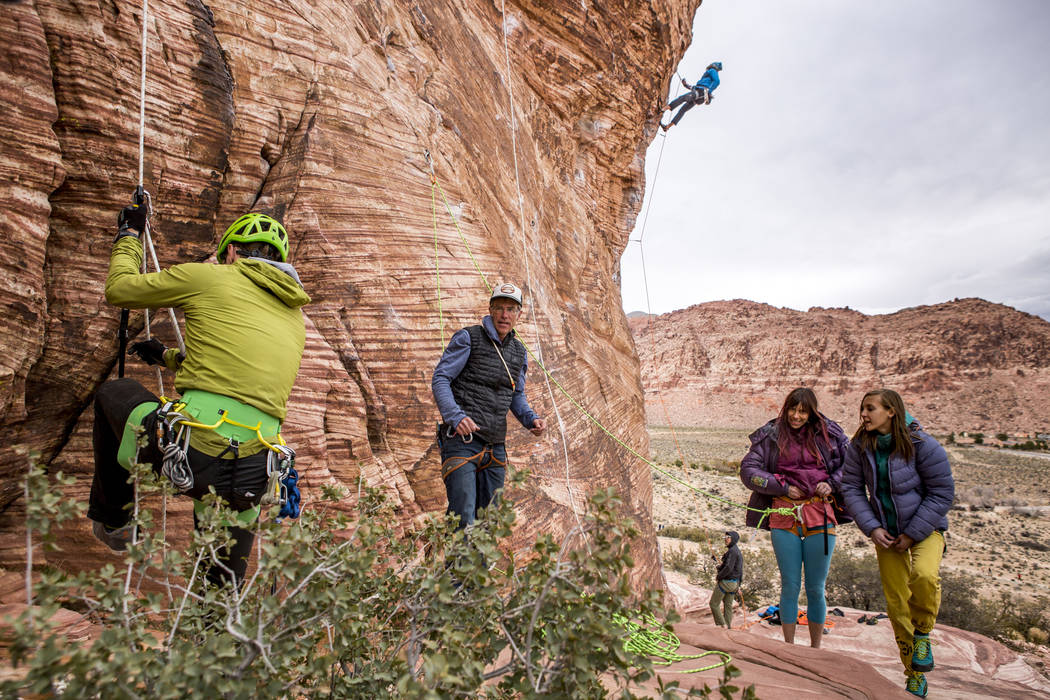 Professional photographer John Evans, second from left, teaches a climbing photography clinic as climbers Gorge Bieker of Arkansas, left, and Greg Tambornino of Minneapolis, third from left, climb ...