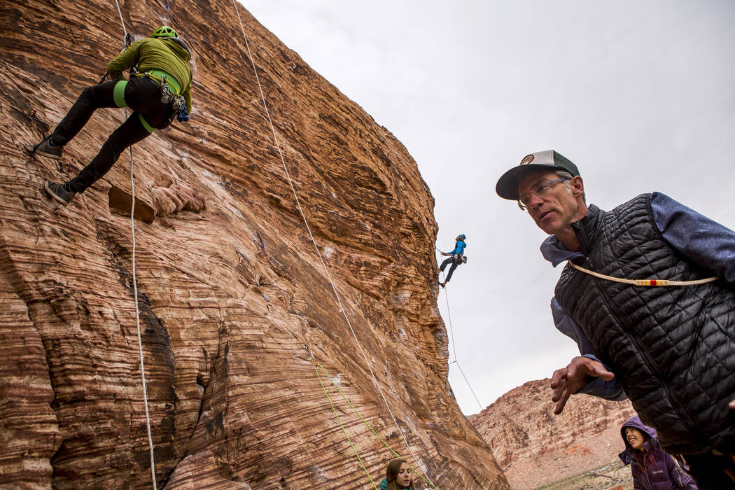Professional photographer John Evans, right, teaches a climbing photography clinic as climbers Gorge Bieker of Arkansas, left, and Greg Tambornino of Minneapolis, second from left, climb their rou ...