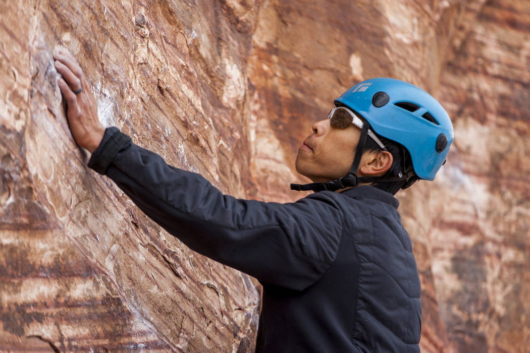 Tommy Chheng of San Francisco looks for his next holds on a route at Calico Basin during Red Rock Rendezvous on Saturday, March 17, 2018.  Patrick Connolly Las Vegas Review-Journal @PConnPie