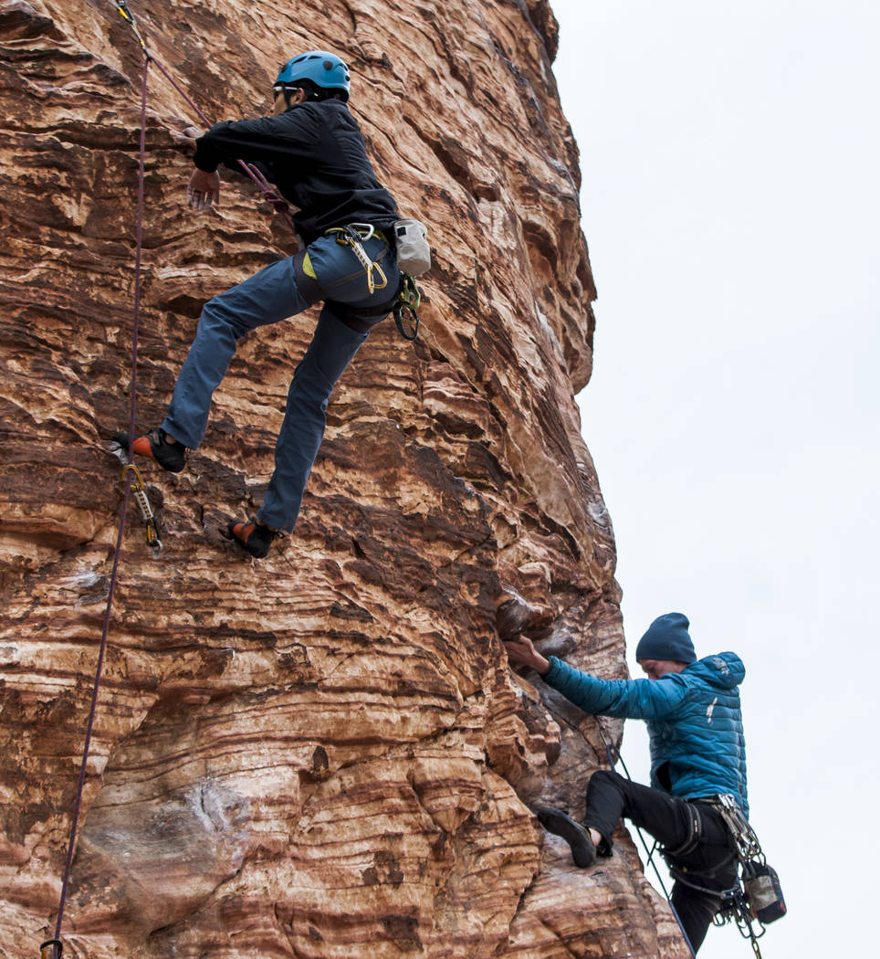 Tommy Chheng of San Francisco, left, and Eric Wesseling of Cincinnati, Ohio, climb a route at Calico Basin during Red Rock Rendezvous on Saturday, March 17, 2018.  Patrick Connolly Las Vegas Revie ...