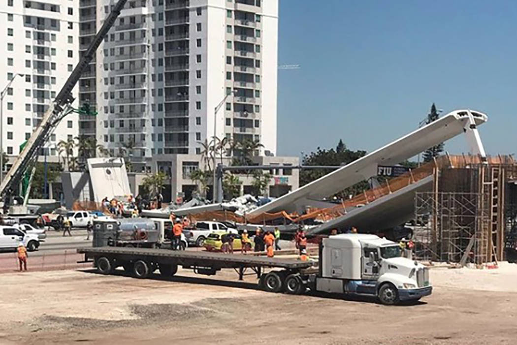 Emergency personnel work at the scene of a collapsed bridge in the Miami area, Thursday, March 15, 2018. (magno.meza/Instagram)