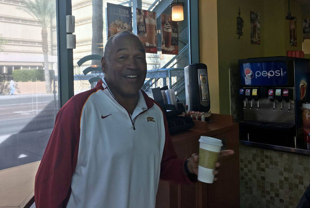 O.J. Simpson after breakfast, pancakes and coffee, with his lawyer at a cafe across the street from the Las Vegas courthouse in Las Vegas, Friday, March 9, 2018. David Ferrara Las Vegas Review-Journal