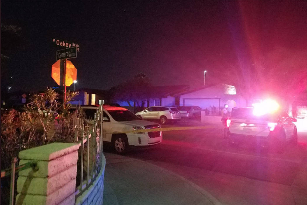 Police investigate a homicide at a house on the 1900 block of Cameron Street in Las Vegas on Friday night. (Mike Shoro/Las Vegas Review-Journal)