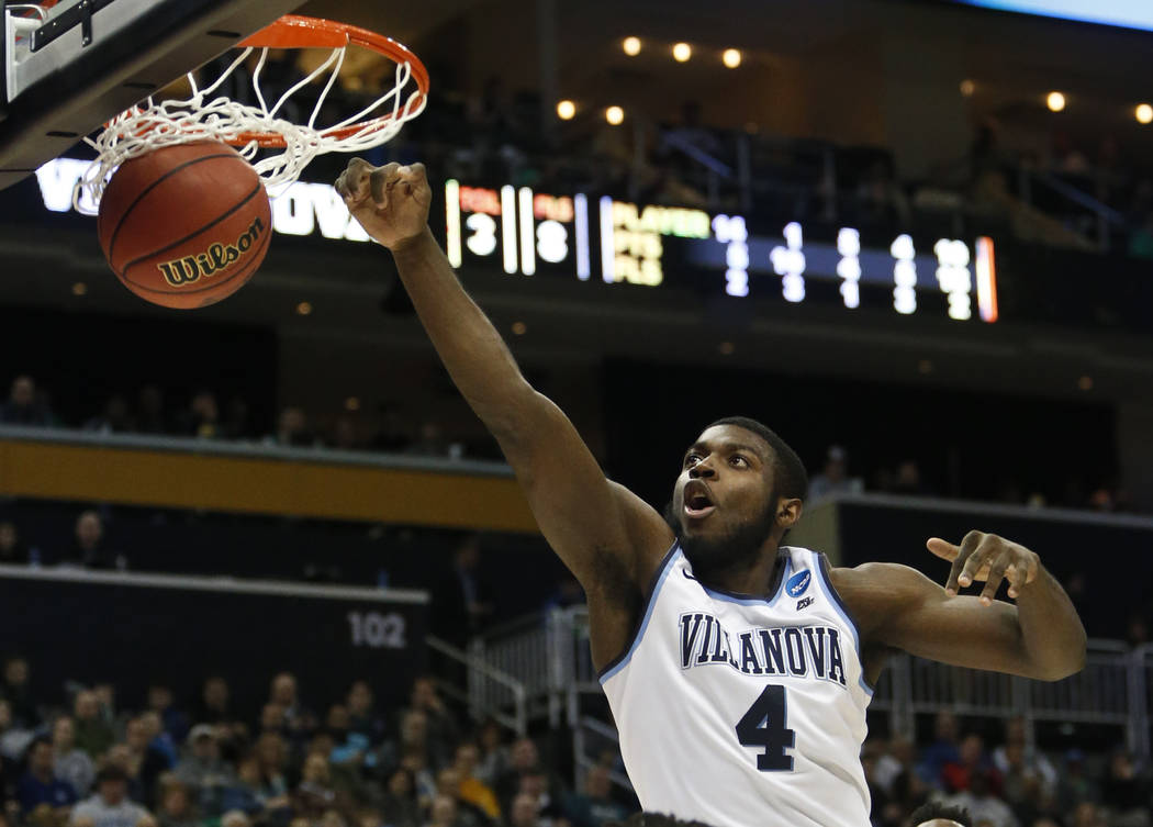 Villanova's Eric Paschall (4) dunks against Alabama during the second half of a second-round game in the NCAA men's college basketball tournament, Saturday, March 17, 2018, in Pittsburgh. Villanov ...