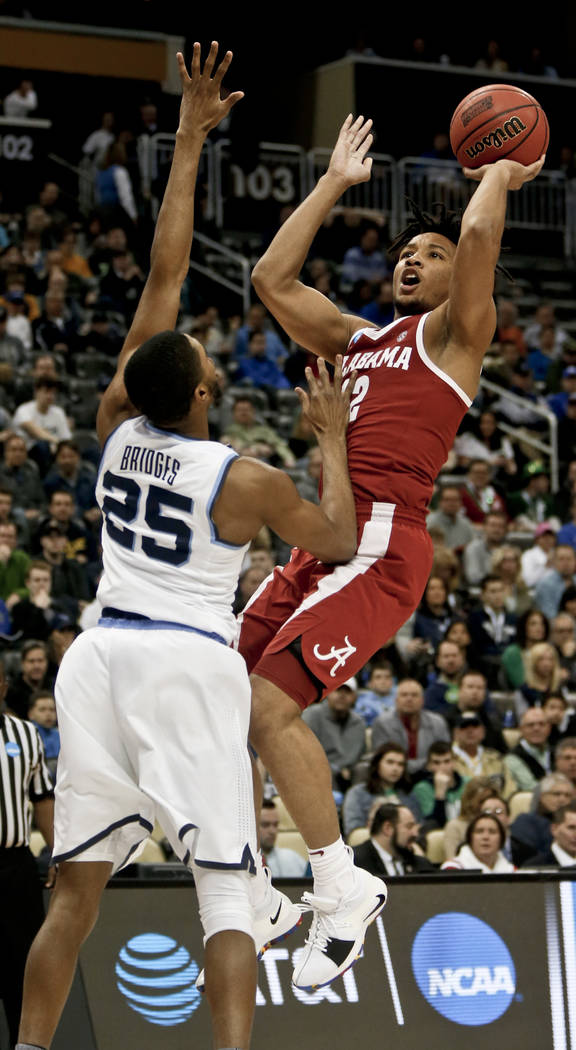 during the first half of a second-round game in the NCAA men's college basketball tournament, Saturday, March 17, 2018, in Pittsburgh. (AP Photo/Keith Srakocic)