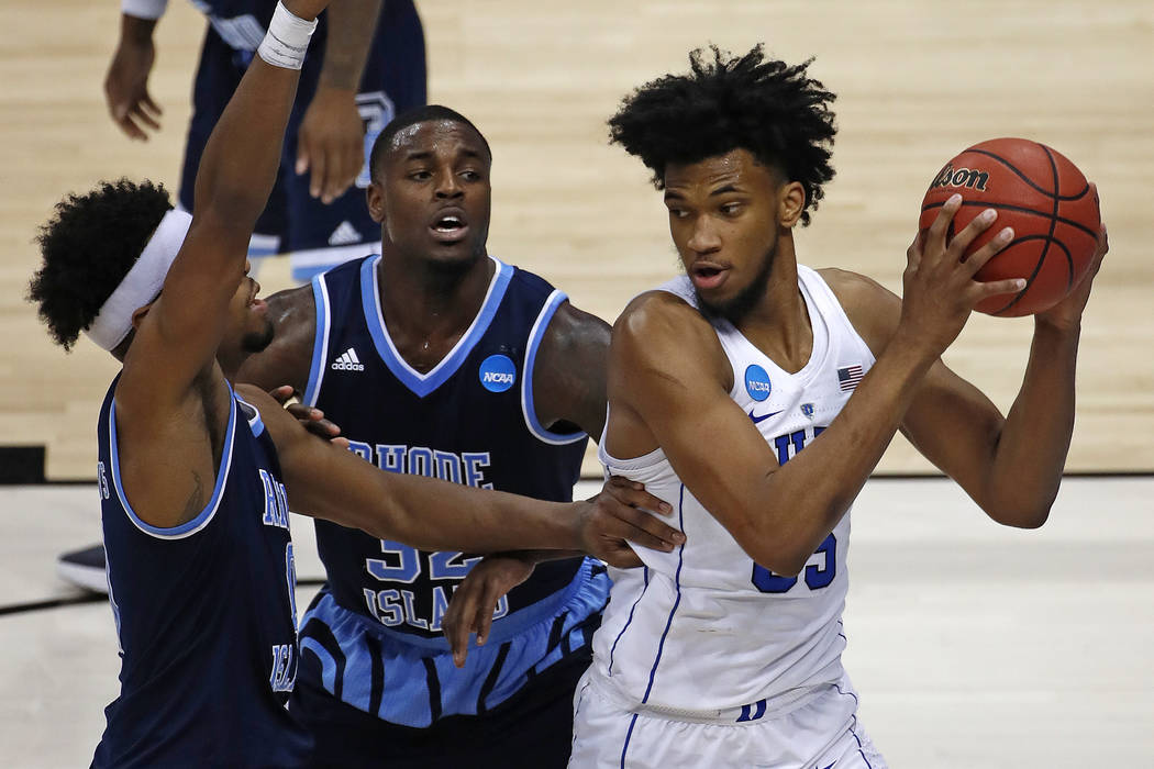 Duke's Marvin Bagley III (35) grabs a rebound in front of Rhode Island's Jared Terrell, center, and E.C. Matthews, left, during the second half of an NCAA men's college basketball tournament secon ...