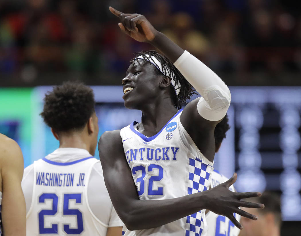Kentucky forward Wenyen Gabriel (32) celebrates a play late in the second half of a second-round game against Buffalo in the NCAA men's college basketball tournament Saturday, March 17, 2018, in B ...