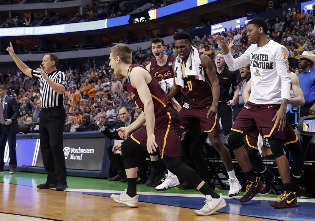The bench celebrates after Loyola-Chicago guard Bruno Skokna scored on a 3-point basket against Tennessee in the second half of a second-round game at the NCAA men's college basketball tournament  ...