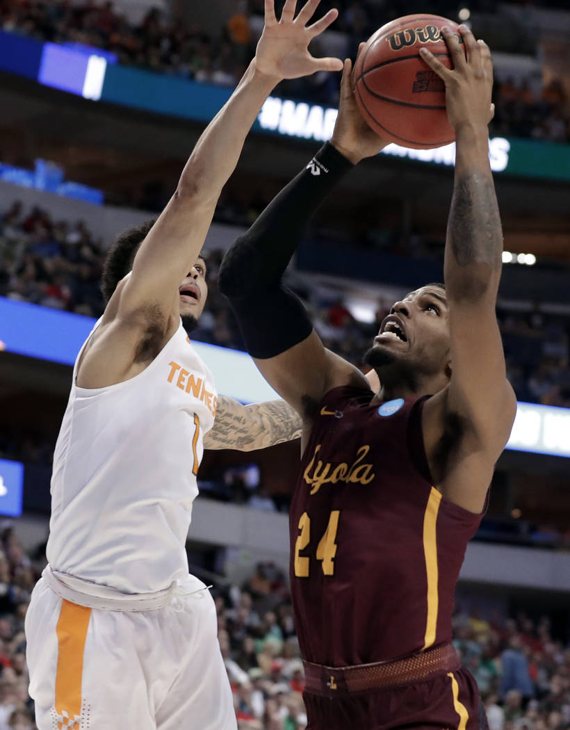 Tennessee guard Lamonte Turner (1) defends as Loyola-Chicago forward Aundre Jackson (24) goes up for a shot during the second half of a second-round game at the NCAA men's college basketball tourn ...
