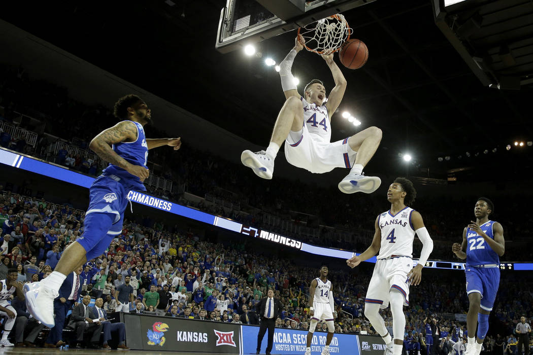 Kansas forward Mitch Lightfoot (44) dunks the ball during the second half of an NCAA men's college basketball tournament second-round game against Seton Hall Saturday, March 17, 2018, in Wichita,  ...
