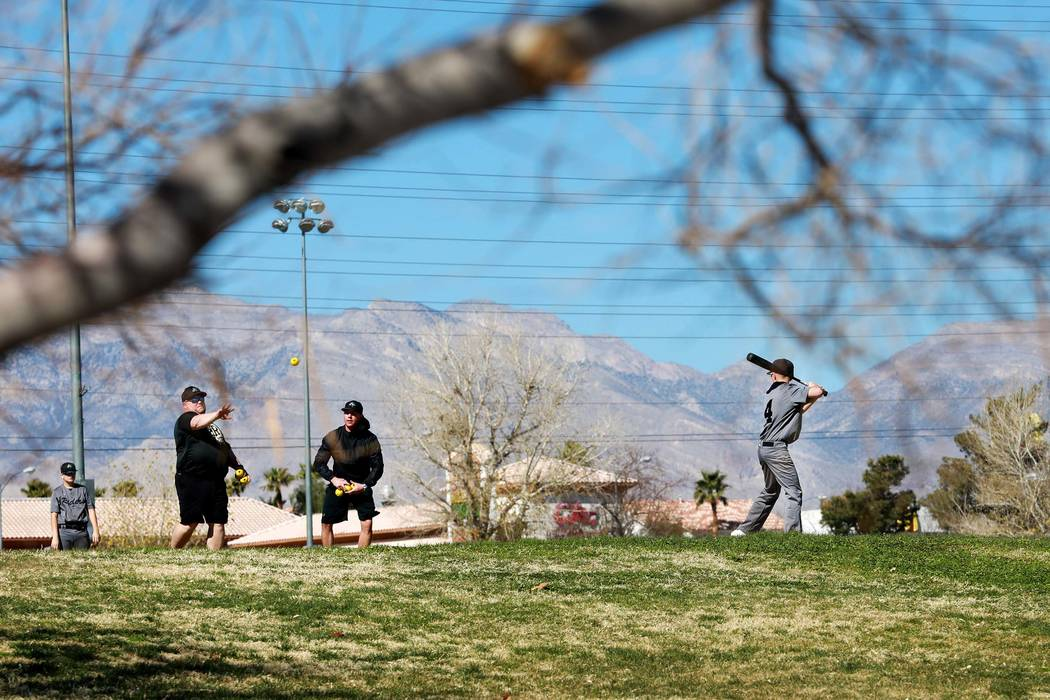 Patrons play baseball at Desert Breeze Park in Las Vegas on Sunday, Feb. 18, 2018. (Andrea Cornejo/Las Vegas Review-Journal) @DreaCornejo