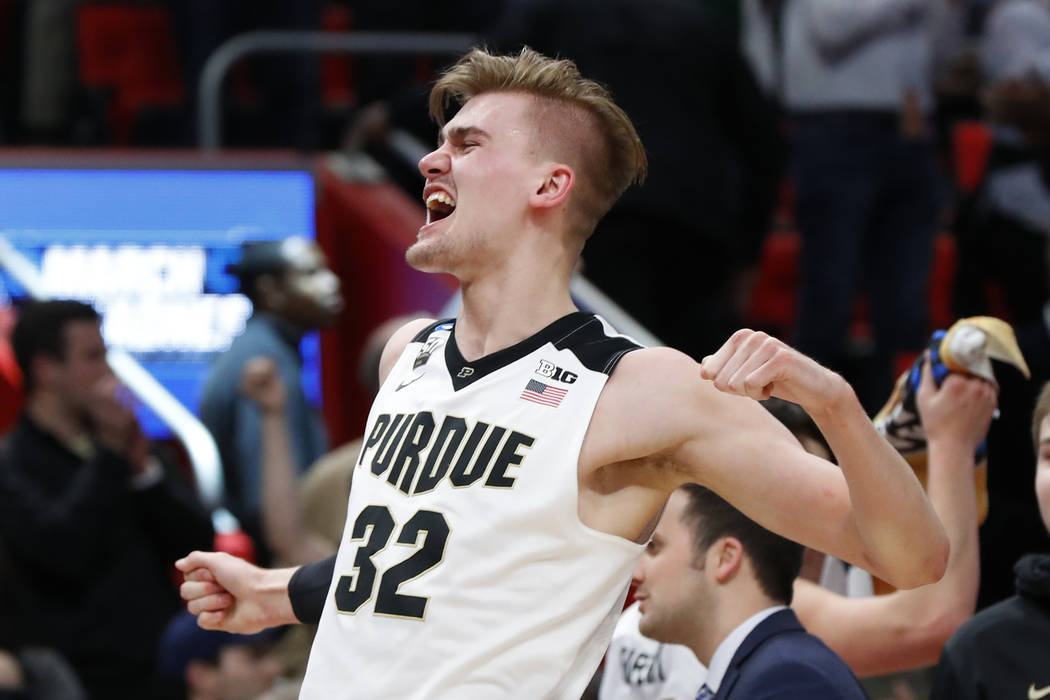 Purdue forward Matt Haarms (32) celebrates a win over Butler in an NCAA men's college basketball tournament second-round game in Detroit, Sunday, March 18, 2018. (AP Photo/Paul Sancya)