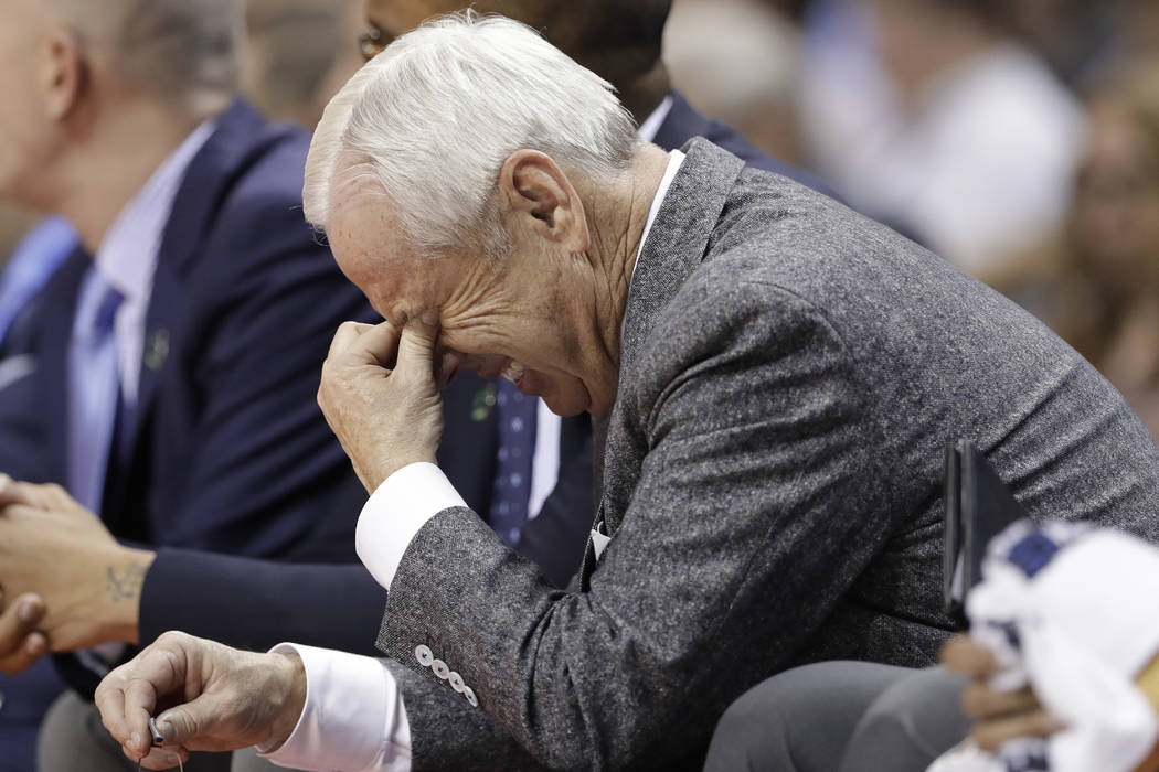 North Carolina head coach Roy Williams lreacts on the bench during the second half of a second-round game against Texas A&M in the NCAA men's college basketball tournament in Charlotte, N.C.,  ...