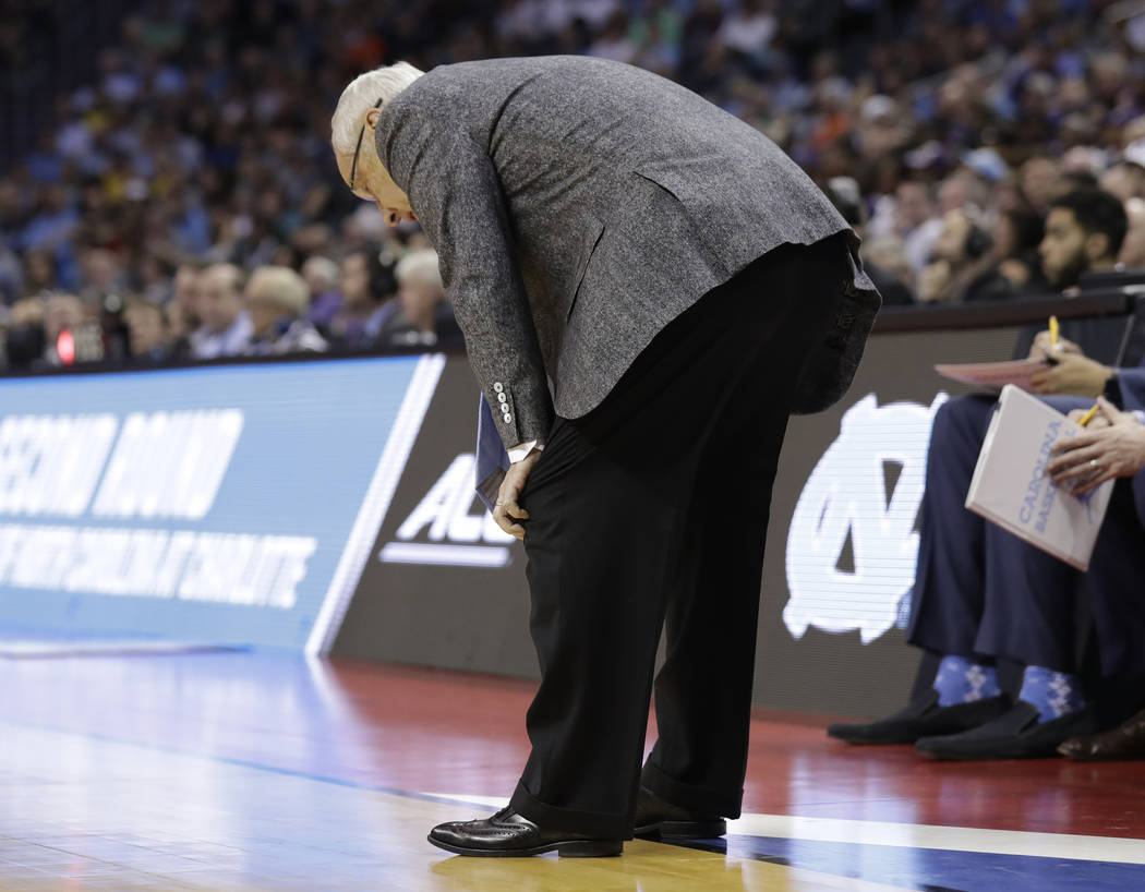 North Carolina head coach Roy Williams bends over in the final minutes during the second half of a second-round game against Texas A&M in the NCAA men's college basketball tournament in Charlo ...