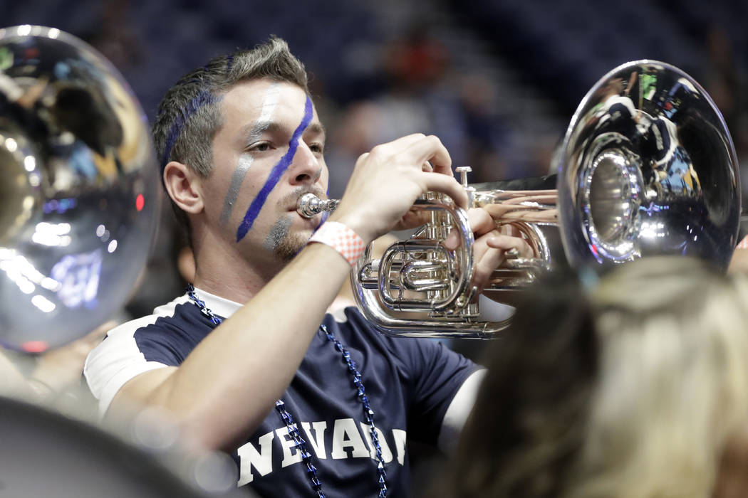 A member of the Nevada band plays before the start of the second-round game against Cincinnati in the NCAA college basketball tournament in Nashville, Tenn., Sunday, March 18, 2018. (AP Photo/Mark ...