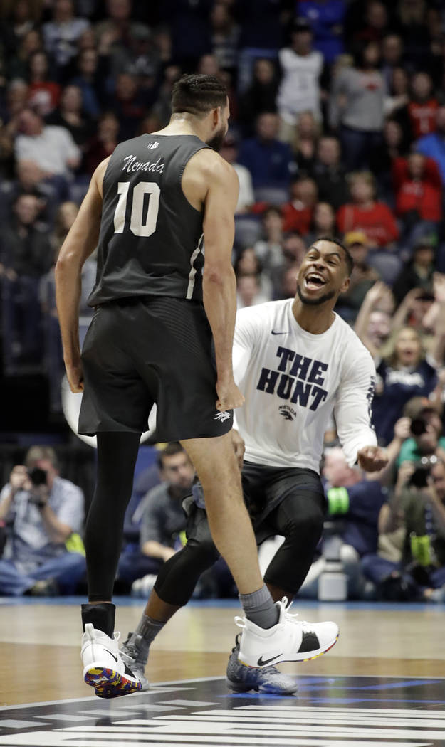 Nevada forward Caleb Martin (10), celebrates with a teammate at the end of the second half of a second-round game against Cincinnati, in the NCAA college basketball tournament in Nashville, Tenn., ...