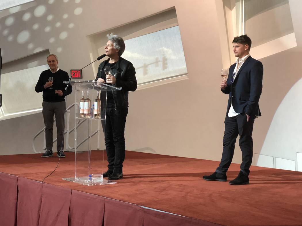 Larry Ruvo, Jon Bon Jovi and Jesse Bongiovi are shown at the launch event for Diving Into Hampton Water Rose at Cleveland Clinic Lou Ruvo Center for Brain Health on Saturday, March 17, 2018. (John ...