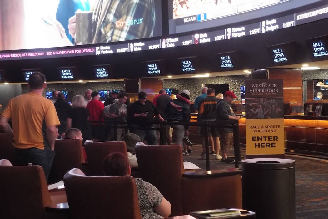 Fans line up to bet on the NCAA Tournament for men's basketball at the Westgate Las Vegas sports book on Thursday, March 15, 2018. (Max Michor/Las Vegas Review-Journal)