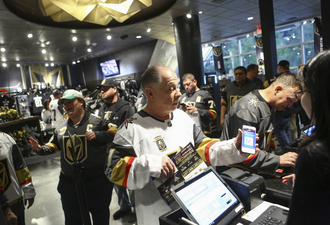 Henderson resident Steve Onorato purchases a limited edition gameday puck before the Golden Knights play the Vancouver Canucks at The Armory at T-Mobile Arena in Las Vegas on Tuesday, March 20, 20 ...