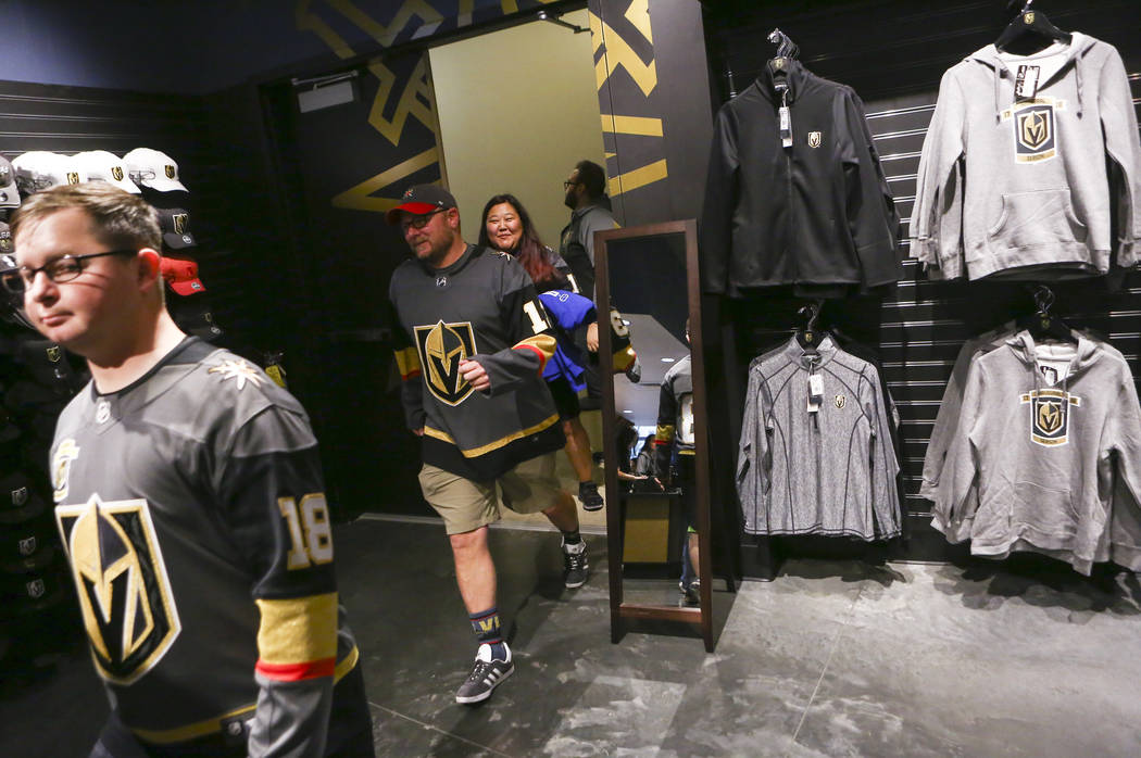 Fans arrive at The Armory to purchase limited edition gameday pucks available to customers before the Golden Knights play the Vancouver Canucks at T-Mobile Arena in Las Vegas on Tuesday, March 20, ...