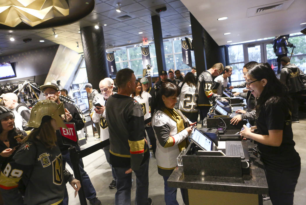 Fans line up at The Armory to purchase limited edition gameday pucks available to customers before the Golden Knights play the Vancouver Canucks at T-Mobile Arena in Las Vegas on Tuesday, March 20 ...