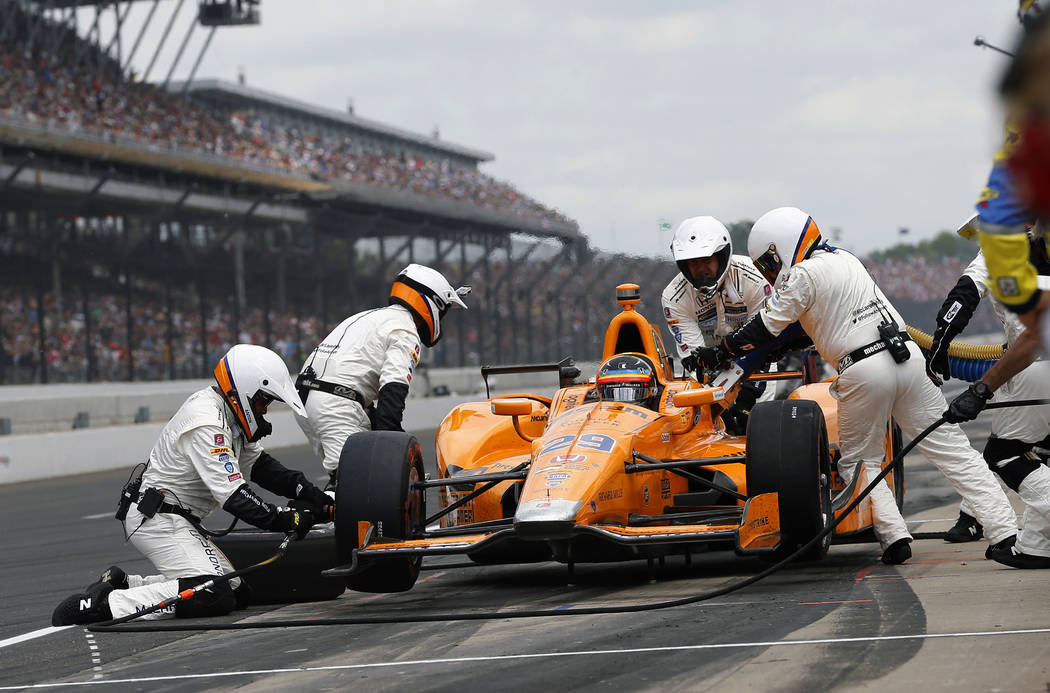 Fernando Alonso, of Spain, makes his first pit stop during the running of the Indianapolis 500 auto race at Indianapolis Motor Speedway, Sunday, May 28, 2017, in Indianapolis. (AP Photo/Sam Riche)