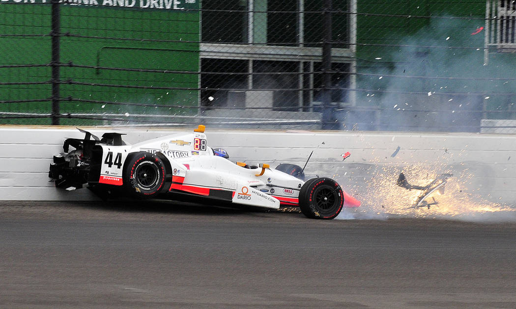 The car driven by Buddy Lazier hits the wall in the second turn during the running of the Indianapolis 500 auto race at Indianapolis Motor Speedway, Sunday, May 28, 2017, in Indianapolis. (AP Phot ...