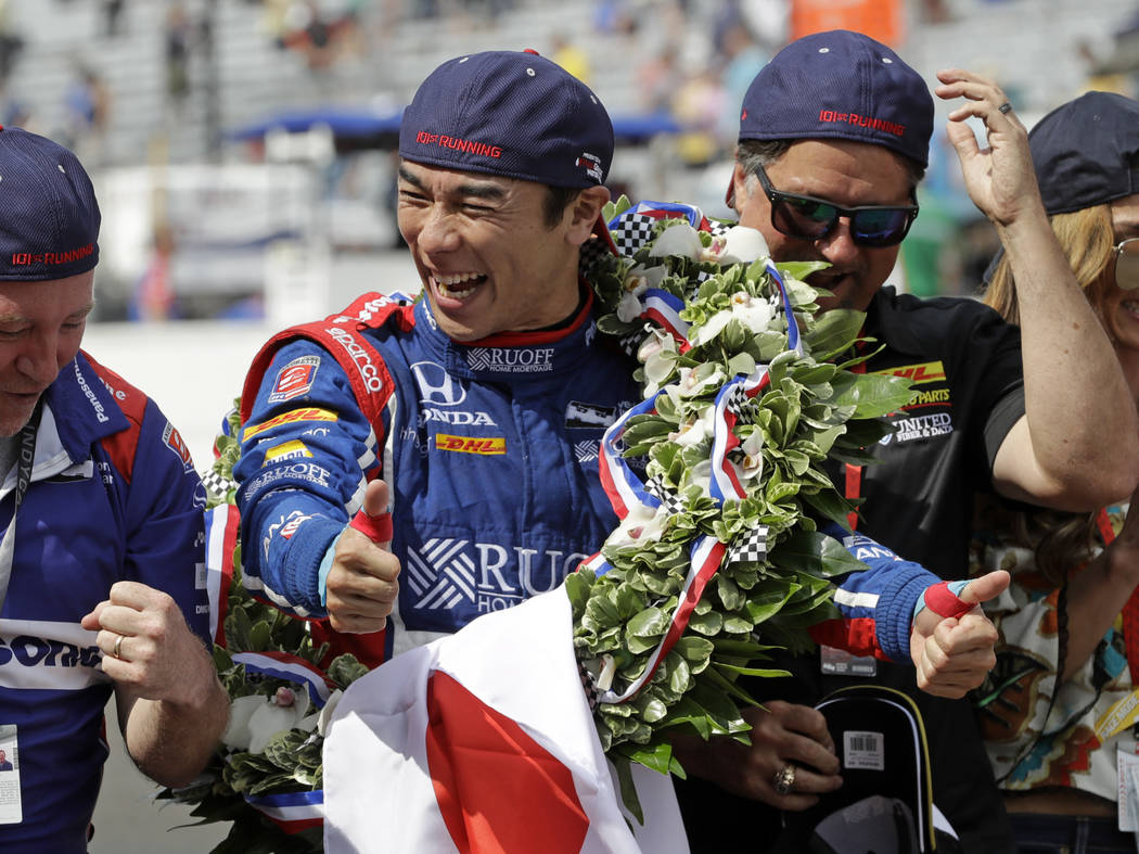 Takuma Sato, of Japan, celebrates on the Yard of Bricks on the start/finish line after winning the Indianapolis 500 auto race at Indianapolis Motor Speedway, Sunday, May 28, 2017 in Indianapolis.( ...