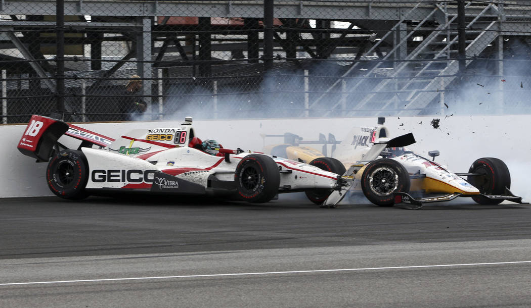 James Davison and Oriol Servia, of Spain, crash in Turn 1 during the running of the Indianapolis 500 auto race at Indianapolis Motor Speedway, Sunday, May 28, 2017, in Indianapolis. (AP Photo/Kirk ...