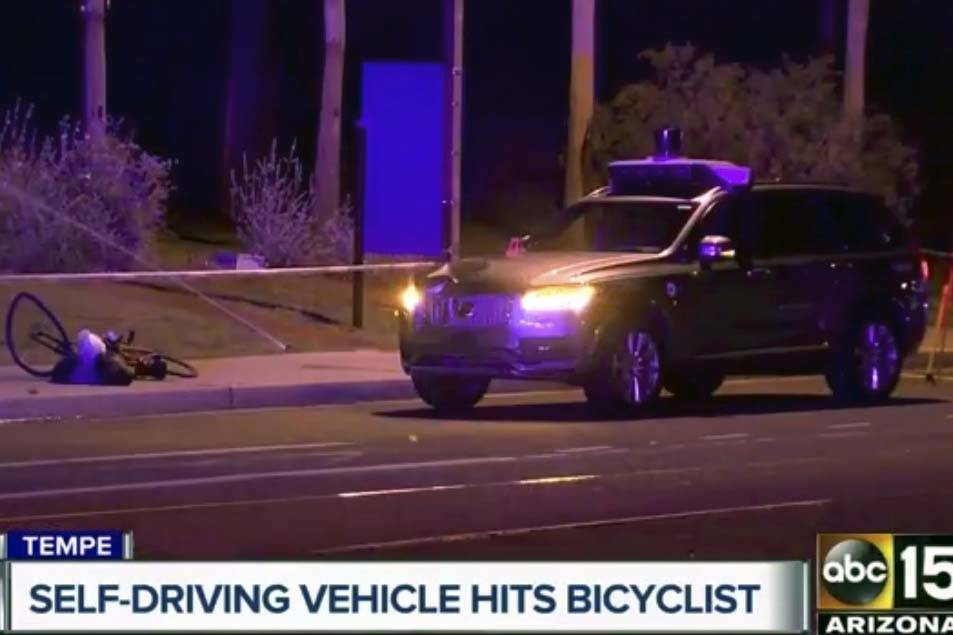 Still image taken from video provided by ABC-15, shows investigators at the scene of a fatal accident involving a self driving Uber car on the street in Tempe, Ariz., March 19, 2018. Police in the ...